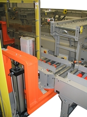 Case Lift and Rotates product for discharge on Motor Driven Roller conveyor