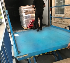 Hydraulic lift used to load and unload product from a truck on a level surface
