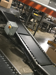 A Motorized Driven Roller (MDR) Conveyor operates via input high voltage 120/240/460/480 line and is transformed into low 24 voltage via an MDR Power Supply (the gray panel box shown on the left).