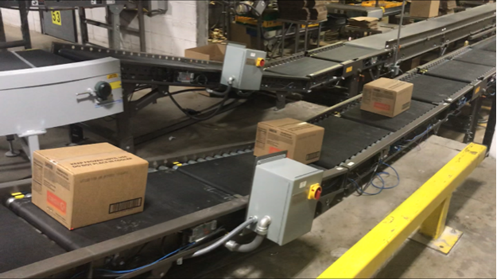 A zoned Motorized Driven Roller (MDR) Accumulation Conveyor, which is controlled via drive cards located in the conveyor frames behind a Lexan cover.