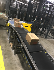 24 volt, zero pressure, zone to zone accumulation Motorized Driven Roller Conveyor which separates and accumulates product onto an automatic palletizer.