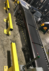 Four zones of a 24 volt Motorized Driven Roller (MDR)  Conveyor which provides separated zones of staged product prior to entering a 90° powered conveyor curve onto a palletizer.