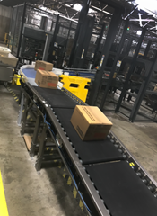 Product is being conveyed onto an automatic palletizer via Motorized Driven Roller (MDR) Conveyor, which separates product to allow zoned accumulation onto the palletizer.