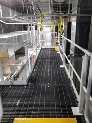 Bar grating being used as floor decking on a mezzanine system.