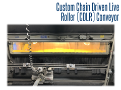 View of the sand blasting area with the CDLR conveyor transporting stone for engraving.