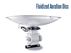 Fluidized aeration discs are are used to create a flow of dry bulk solids from vertical storage bins and silos.
